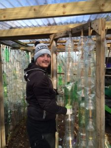 James from Ballark building the Recycled Plastic Bottle Greenhouse